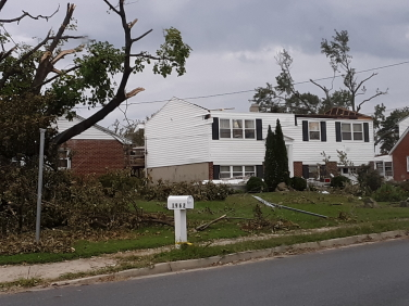 A house with its roof torn off by a hurricane.