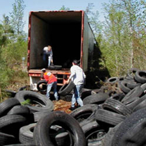 Youth loading scrap tires into truck