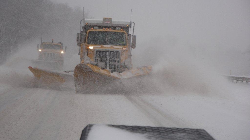 Snow plows plowing the roads.