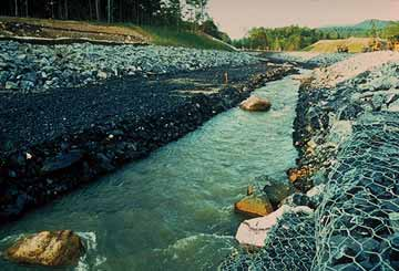gabion baskets lining a waterway